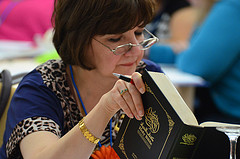 people studying bible photo